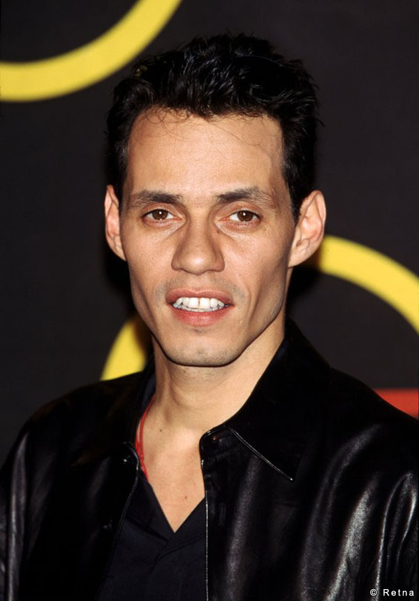 The 49-year old son of father Felipe Muñiz and mother Guillermina, 173 cm tall Marc Anthony in 2018 photo